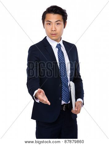 Young business man extending hand to shake