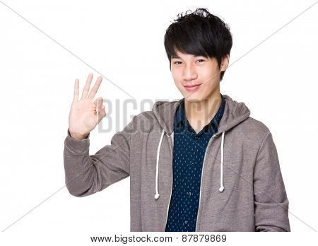 Young asian man showing okay sign