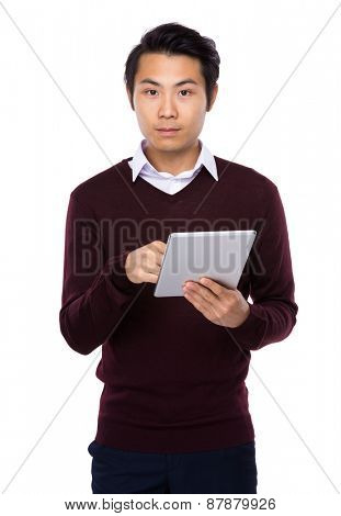 Cheerful Asian man using a tablet PC