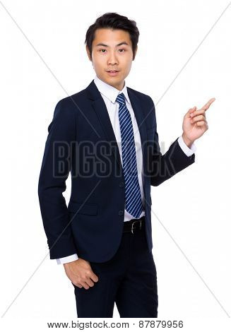 Young asian man indicated upside