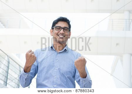 Man celebrating his success, modern office background.