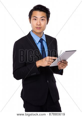 Asian business man using tablet computer