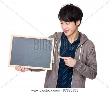 Young man finger point to chalkboard
