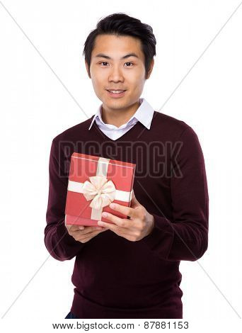 Asian businessman with red gift box