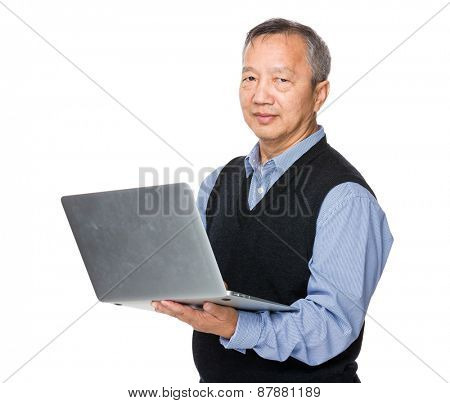 Asian man use of notebook computer
