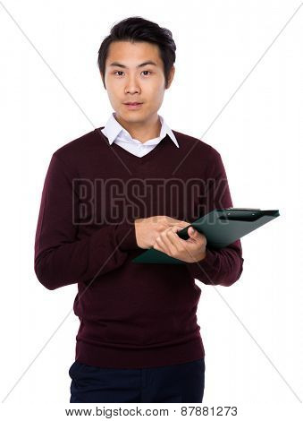 Young attractive businessman with check list board