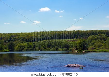 Landscape Of A Green Grassy Hills, Valley, Trees And Blue Sky And River