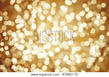 Golden Background With Natural Bokeh Defocused Sparkling Lights. Colorful Metallic Texture