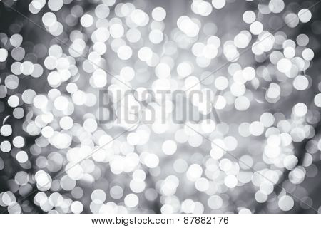 Silver Background With Natural Bokeh Defocused Sparkling Lights. Colorful Metallic Texture