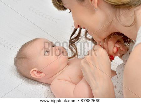 Mother Tenderly  Looking At Baby