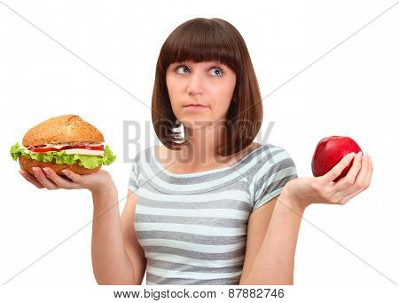 Portrait Of Pretty Young Girl Deciding What To Eat Hamburger Or Apple
