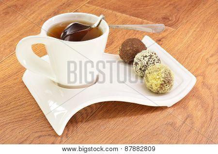 Black Tea In A White Mug And Cake