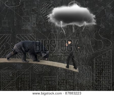 Businessman Against Bear Balancing On Plank With Gray Cloud Raining
