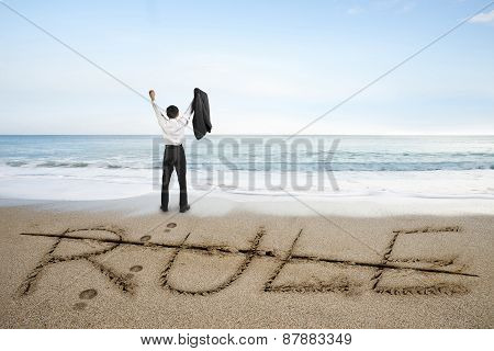 Businessman Cheering With Rule Word Deleted Line On Sand Beach