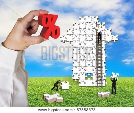 Hand Holding Percentage Sign With Business Men Building Arrow Puzzle