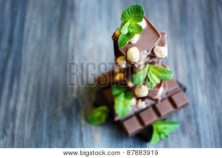 Set of spicy chocolate on wooden background