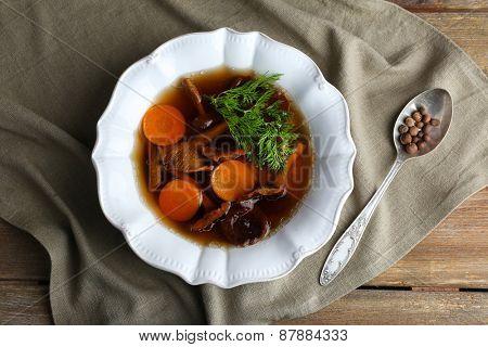 Mushroom soup on gray napkin, top view