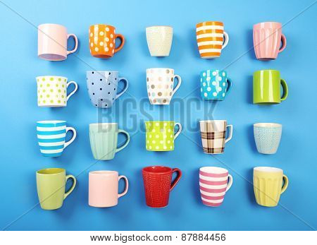 Group of colorful cups on color table, closeup