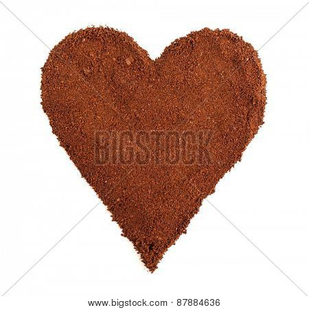 Ground coffee in shape of heart isolated on white