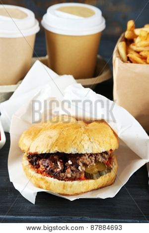 Tasty burgers on wooden table background, close-up Unhealthy food concept