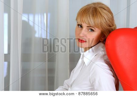 Portrait Of Business Woman Who Sits In Chair