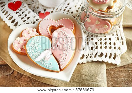 Heart shaped cookies for valentines day and teapot on  wooden background