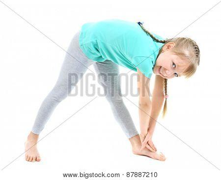 Little girl doing exercises isolated on white