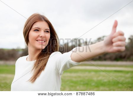 Relaxed woman saying Ok with her hand in the meadow