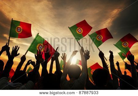 Silhouettes of People Holding Flag of Portugal