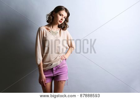 Portrait of beautiful model on gray background