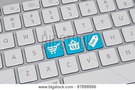 Online shopping concept with a high angle view of a white computer keyboard with three blue keys depicting a shopping cart, basket and price tag with the word Sale. 3d Rendering.