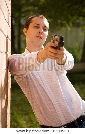 Man Aiming A Black Gun