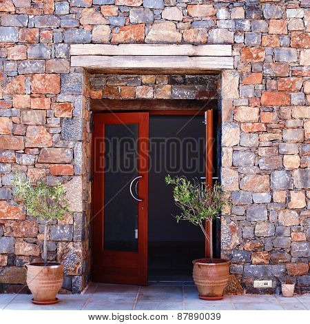 Open Door And  Stone Mediterranean Wall(greece)