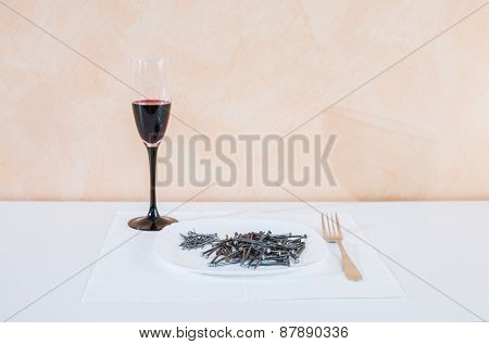 Nails Lying On The Plate.serving