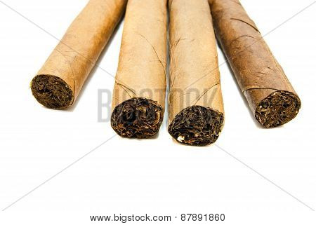 Four Cuban Cigars On White