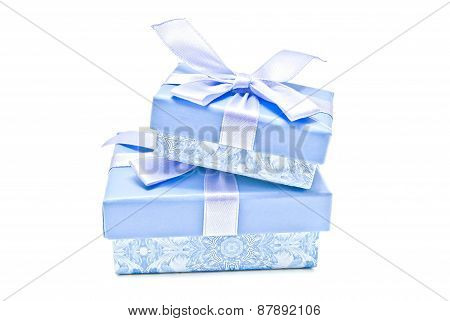 Two Blue Gift Boxes On White