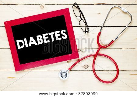 Blackboard with diabetes and stethoscope