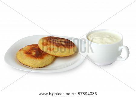 pancakes on the plate with the Ira on a white background