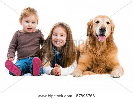 two cute sisters  with her dog golden retriever in the studio. Isolated on white background
