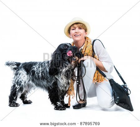 happy woman sit with her dog cocker spaniel in a studio isolated on a white background