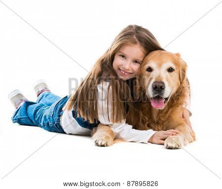 Happy cute little girl with her dog golden retriever