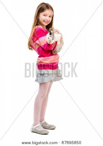little smiling girl in a crimson sweater  with baby rabbit over white