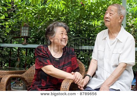 A Senior Couple Look At Each Other Lovely.