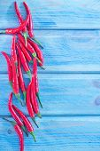 picture of chillies  - chilli pepper on the blue background fresh chilli pepper - JPG