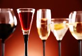 foto of ethanol  - Composition with glasses with assorted alcoholic beverages - JPG