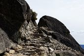 stock photo of rock carving  - Trail Stone Staircase Carved Into Granite Rock - JPG
