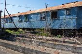 picture of passenger train  - Old and abandoned passenger train wagons in sunny day - JPG