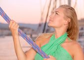 picture of rope pulling  - Portrait of a beautiful woman sailing - JPG