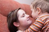 image of kiss  - Closeup of happy mother kissing her child boy - JPG