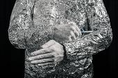 image of cyborg  - Closeup of cyborg fixing himself with screwdriver - JPG